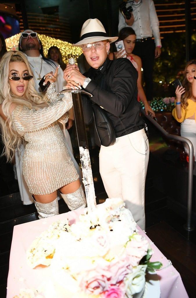Jake Paul and Tana Mongeau cut the wedding cake at Sugar Factory.