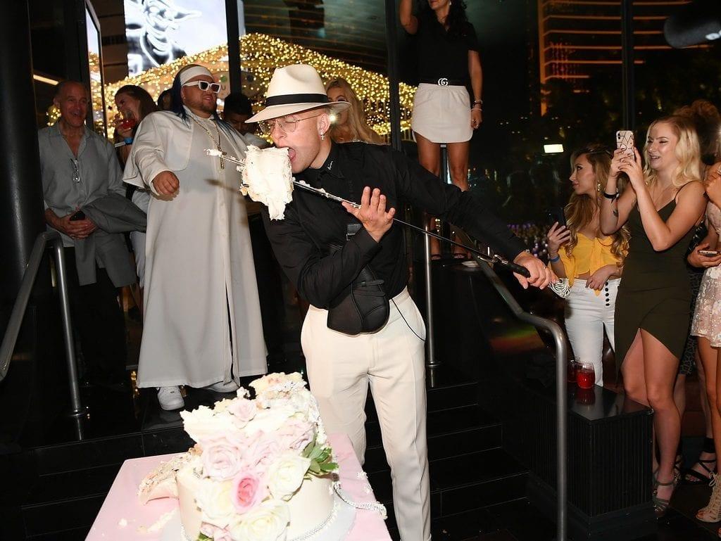 Jake Paul eating the wedding cake sword at Sugar Factory.