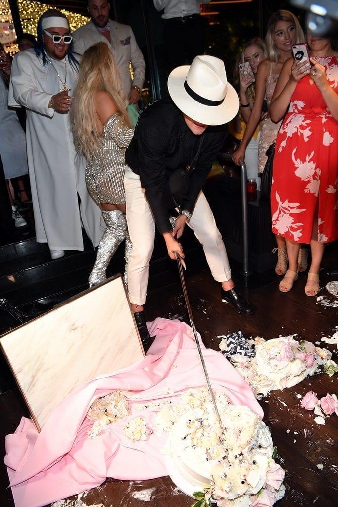 Jake Paul smashing the wedding cake at Sugar Factory.