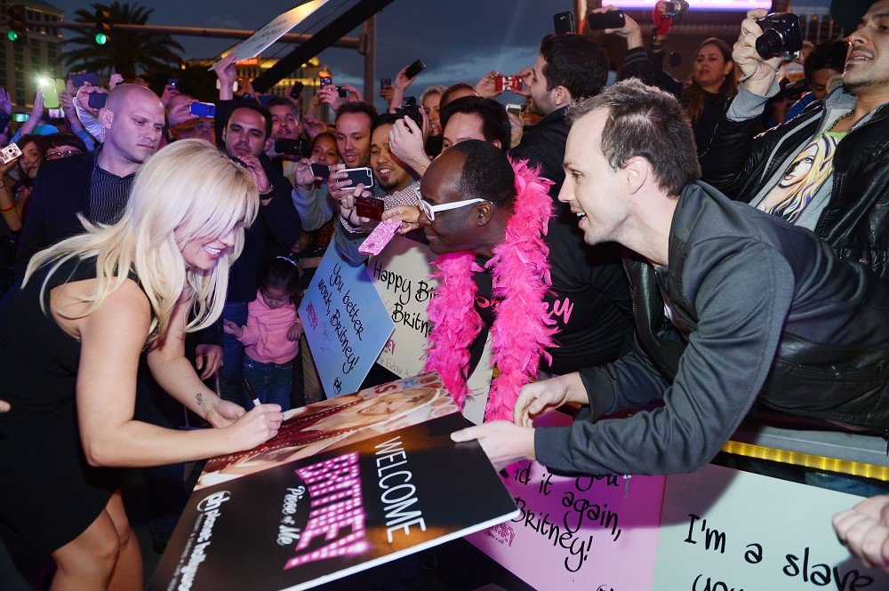 Britney Spears signs autographs for fans at her welcome event at Planet Hollywood Resort & Casino in Las Vegas on Tuesday, Dec. 3. Photo Credit – Denise Truscello/WireImage