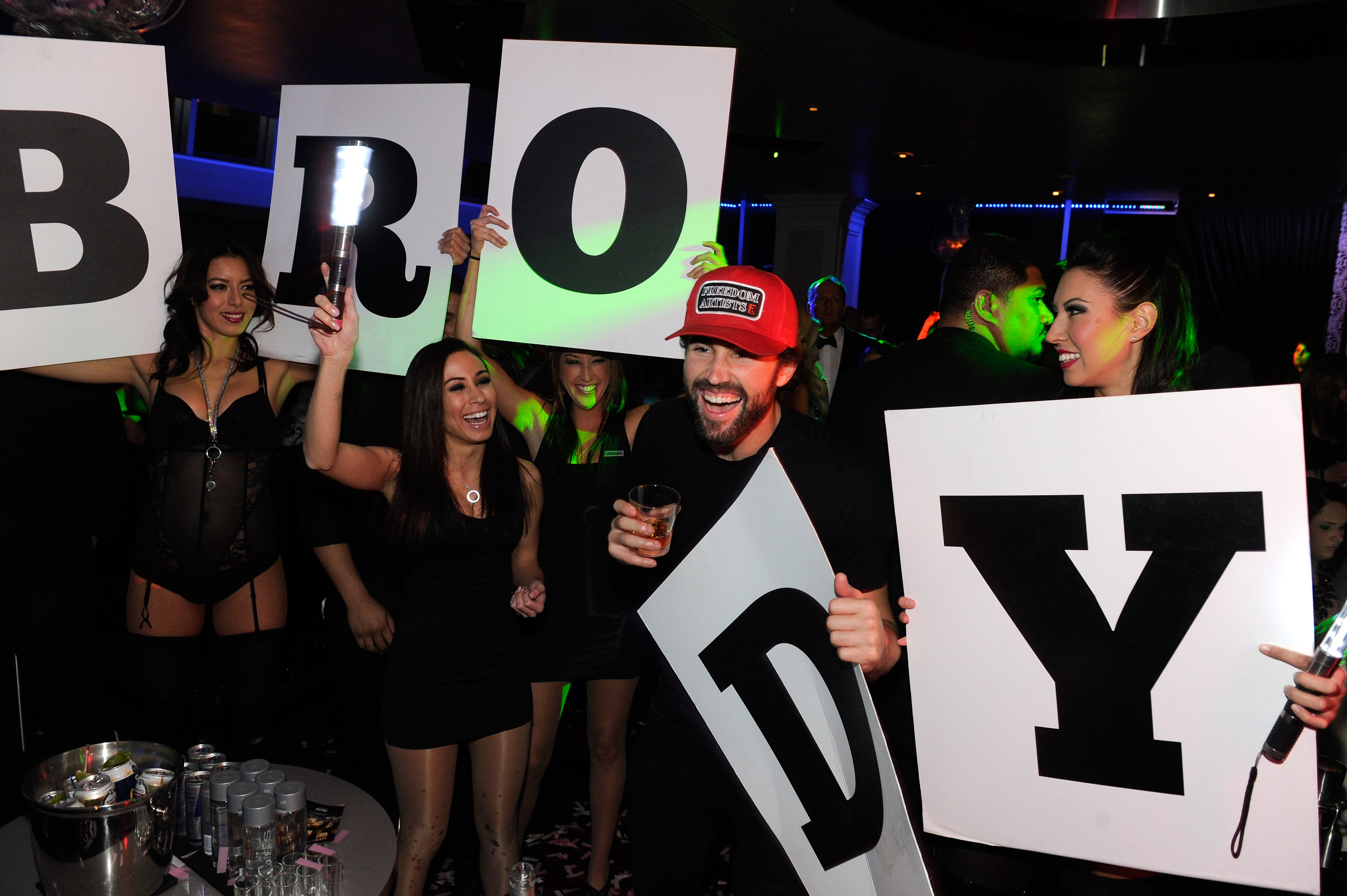 Brody Jenner rages in excitement with go go dancers inside Ghostbar at Palms Casino Resort.