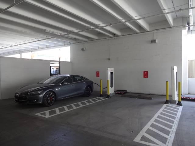 Tesla at a Tesla Supercharger