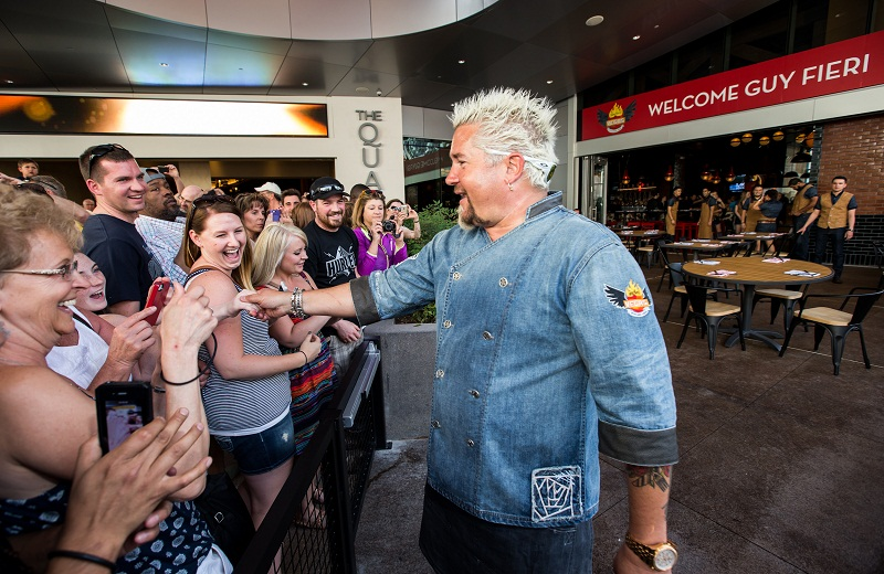 Guy Fieri greets fans on opening day of Guy Fieri's Vegas Kitchen & Bar at The Quad Resort & Casino on Thursday, April 17, 2014.