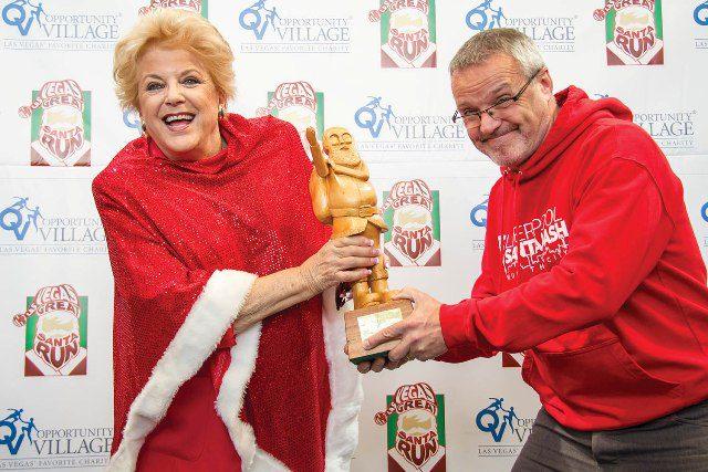 Mayor Carolyn Goodman and  Liverpool's Santa Dash's Alan Rothwell Fight for the World Santa Challenge  Trophy