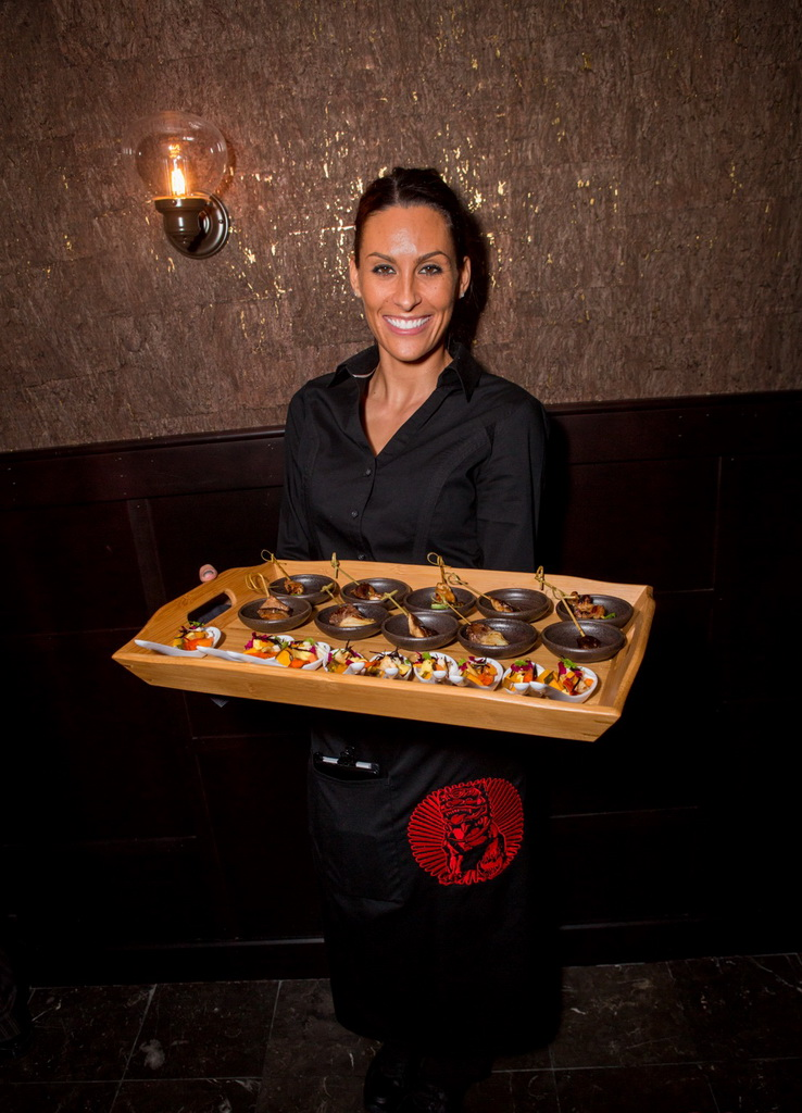 Server Serving Selections of Yakitori