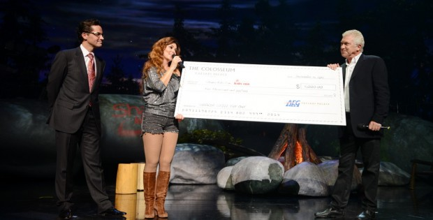 General Manager of Caesars Palace Sean McBurney (L) and President of Global Touring with AEG Live John Meglen (R) present a check to Shania Twain (C) for her Shania Kids Can Foundation during her final performance of SHANIA: STILL THE ONE at The Colosseum at Caesars Palace on Dec. 13, 2014 in Las Vegas, Nev. (Photo by Denise Truscello/WireImage)