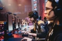 """Andrew """"Andinster"""" Woodward of Spacestation Gaming competes onstage during the Smite match at Esports Arena Las Vegas' grand opening"""