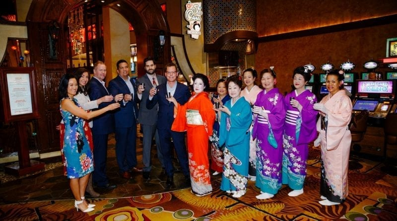 Silverton executives toast with Japanese dancers to Su Casa grand opening