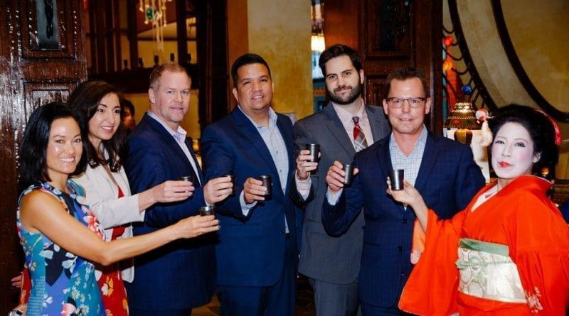 Silverton executives toast with Sake to Su Casa