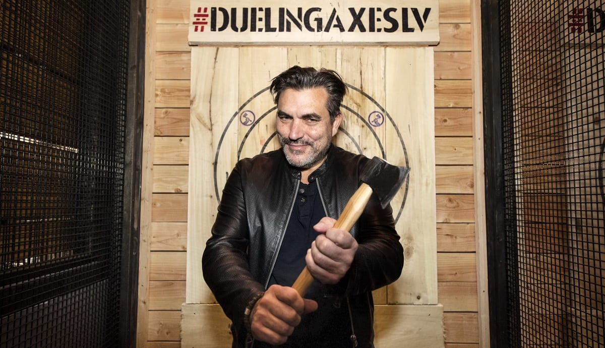 Todd English poses for a photo opportunity at Dueling Axes