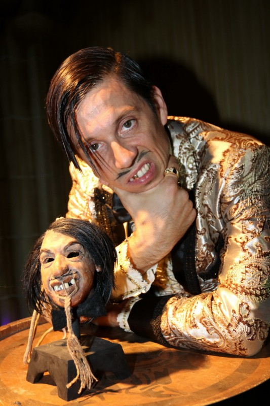 The-Gazillionaire-poses-with-his-shrunken-head-at-The-Golden-Tiki
