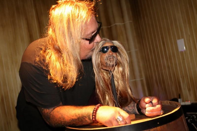 Vince-Neil-with-shrunken-head-1