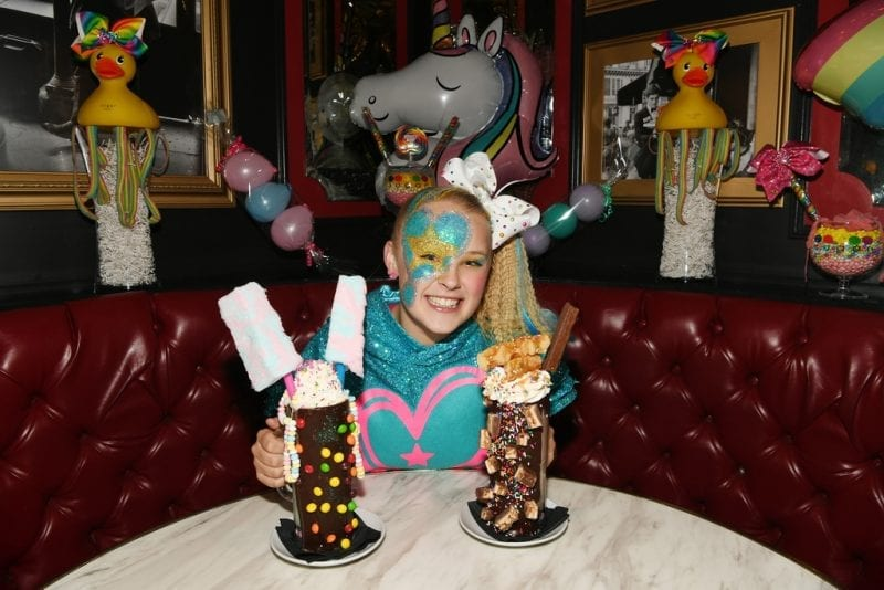 JoJo Siwa indulges in the Tie Dye Insane Milkshake and Giggles Snickers Insane Milkshake.