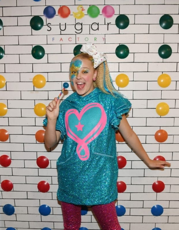 JoJo Siwa poses at Sugar Factory signature dot wall.