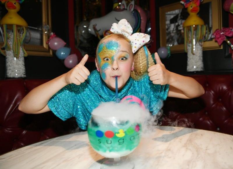 JoJo Siwa sips on non-alcoholic ocean blue goblet.