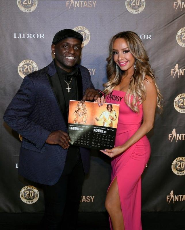 Lorena Peril and Sean E Cooper with Calendar