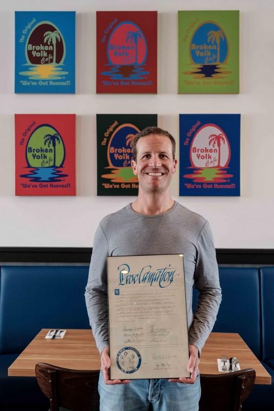 1241 Las Vegas franchise owner Randy Corrigan with Clark County proclamation honoring Broken Yolk Cafe.